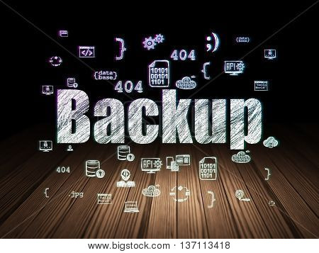 Database concept: Glowing text Backup,  Hand Drawn Programming Icons in grunge dark room with Wooden Floor, black background