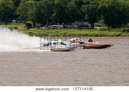 Madison Indiana - July 2 2016: Steve Kuhr II in the GNH 317 Danny Walls in the GNH 68 and matt Mattson in the GNH 76 race in the Grand National Hydroplane Qualification Heat #1 at the Madison Regatta in Madison Indiana July 2 2016.