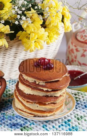 Pancake cake with cream on a plate Still High cranberry cowberry