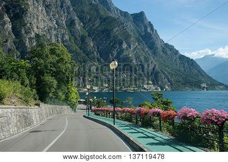 Beautiful Lakeside Road With Flower Decoration Near Limone, Garda Lake