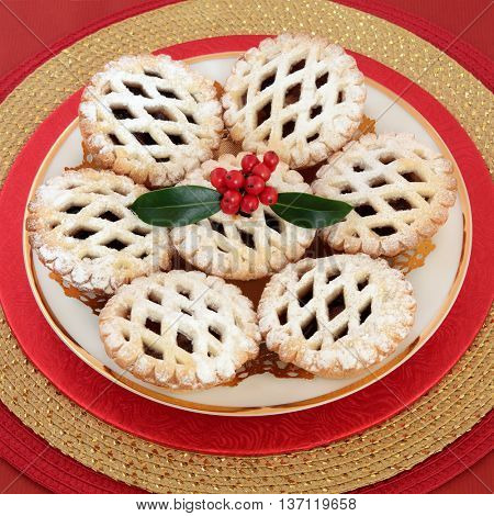 Christmas latticed mince pie cakes with holly and berries.