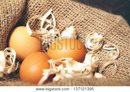 Three Domestic Eggs On Sackcloth