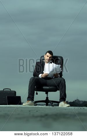 Businessman With Paper In Outdoor Office