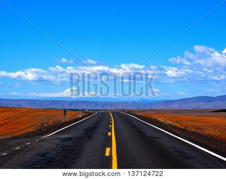 Roadtrip On Open Road with Mountain Backdrop
