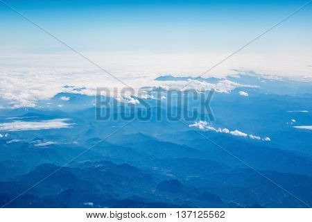 aerial view of the mountains and clouds from an airplane