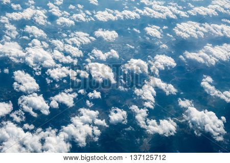 aerial view of the clouds and land background from an airplane