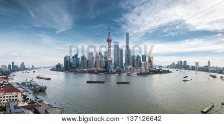 panoramic view of shanghai skyline against a blue sky China