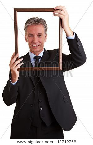 Senior Manager Holding Empty Frame