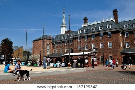 Alexandria Virginia - April 13 2014: Musicians performing on a covered stage entertain in Market Square next to Alexandria City Hall