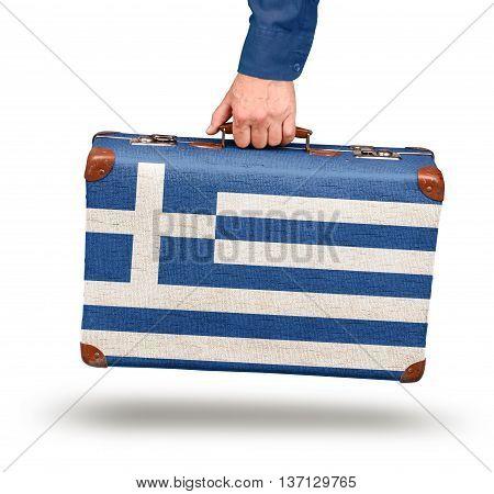 Hand holding vintage Greek flag suitcase isolated on white