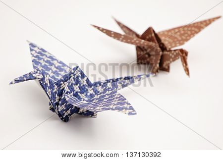 Two texture paper cranes origami with white background