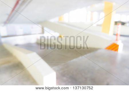 Blurred Underground Parking Garage Interior With A Parked Cars