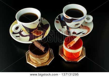 Chocolate And Fruit Pastry On Black Background With Cup Of Coffee