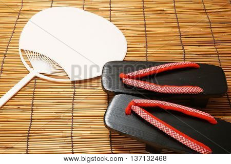 Japanese sandals and fan. Concept of Japanese summer.