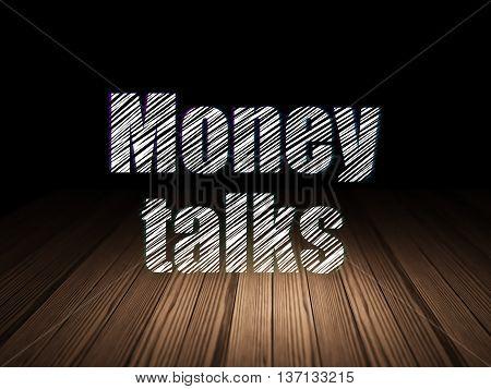 Business concept: Glowing text Money Talks in grunge dark room with Wooden Floor, black background