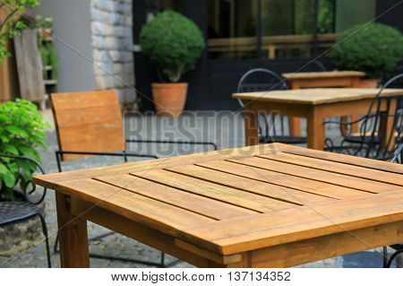 Empty Dining Tables And Chairs In European Style Ambiance