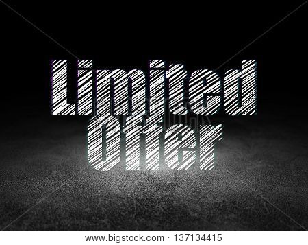 Business concept: Glowing text Limited Offer in grunge dark room with Dirty Floor, black background