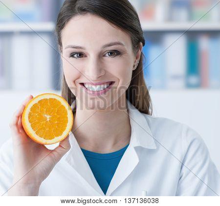 Nutritionist Holding A Sliced Orange