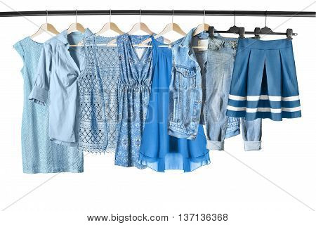 Set of blue clothes on clothes racks isolated over white