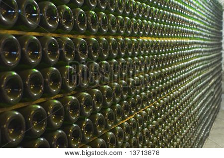 Wine-bottles old and dusty containing wine