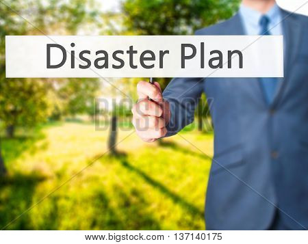 Disaster Plan - Businessman Hand Holding Sign