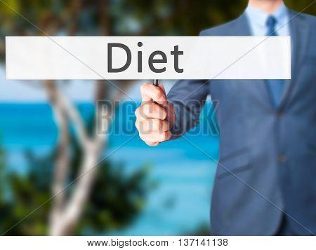 Diet - Businessman Hand Holding Sign