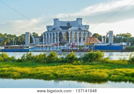 VELIKY NOVGOROD RUSSIA - JUNE 21 2016. Summer evening arhitecture landscape of Novgorod Regional Drama Theatre at the bank of the Volkhov river in summer evening. Picturesque architecture view