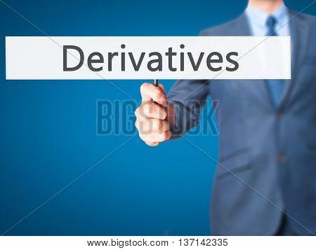 Derivatives - Businessman Hand Holding Sign