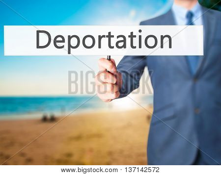 Deportation - Businessman Hand Holding Sign