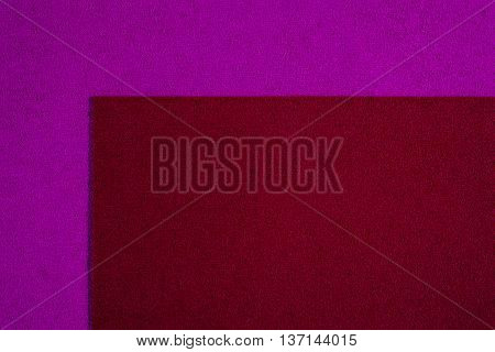 Eva foam ethylene vinyl acetate red surface on pink sponge plush background
