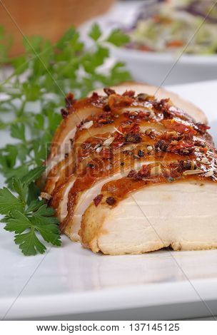 Baked chicken breast with spice sliced on a plate