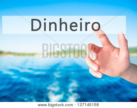 Dinheiro (money In Portuguese) - Hand Pressing A Button On Blurred Background Concept On Visual Scre