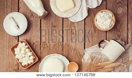 Milk and cheese on wooden background. Jewish holiday shavuot celebration. View from above. Flat lay