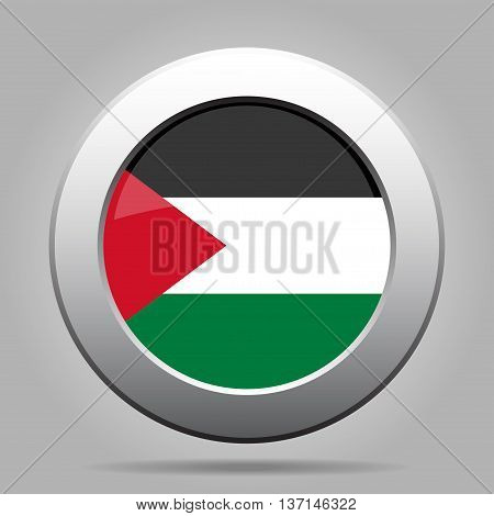 metal button with the national flag of Palestine on a gray background