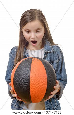 a preteen girl with a basketball isolated on white background