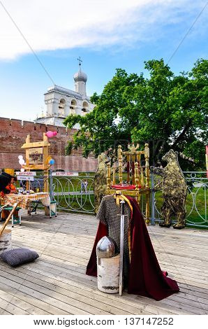 VELIKY NOVGOROD RUSSIA -JUNE 11 2016. Belfry of St Sophia cathedral with tourist attraction objects on the foreground and souvenir trade in Veliky Novgorod Russia