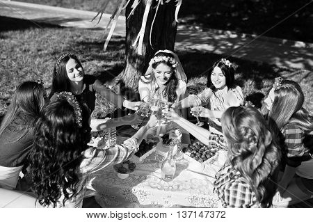 Girls drinking champagne at bachelorette party outdoor