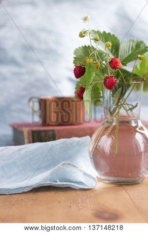 Tasty woodland strawberry in a glas vase