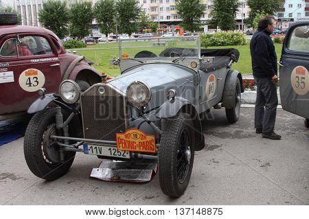 PERM RUSSIA - JUNE 29: Rally of retro-cars Peking-Paris 2016 June 29 2016 in Perm Russia. Cars are near the hotel.