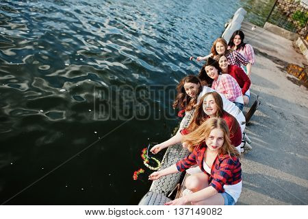 Group Of Girls At Bachelorette Party Let The Wreaths On The Water