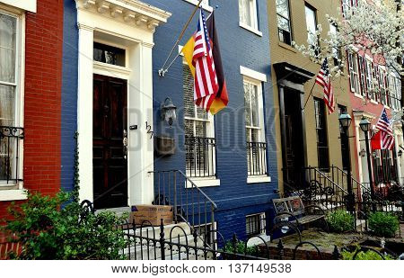 Washington DC - April 11 2014: 19th century homes on C Street SE in the Capitol Hill East historic district flying flags