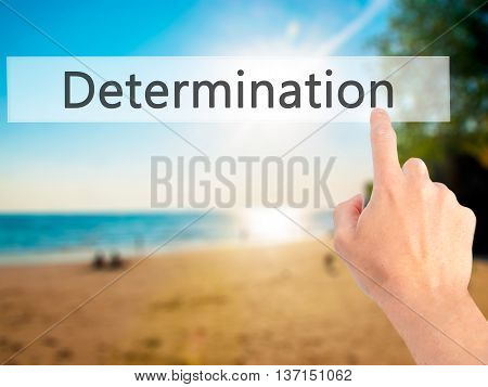 Determination - Hand Pressing A Button On Blurred Background Concept On Visual Screen.