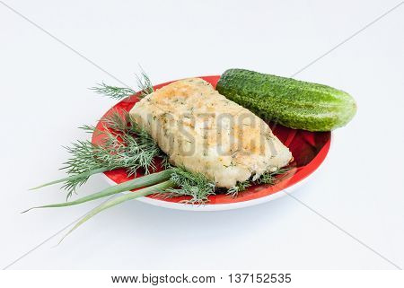 Cookery. The potato and cheese fried rolls with vegetables and a pickle on a red plate