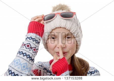 portrait of a young girl with a winter cap isolated on white background