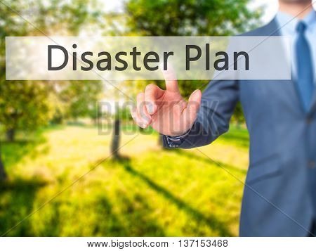 Disaster Plan - Businessman Hand Pushing Button On Touch Screen
