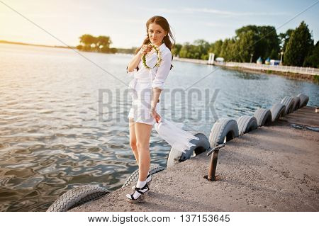 Girl At Bachelorette Party With Wreath And Veil Background Lake On Sunset
