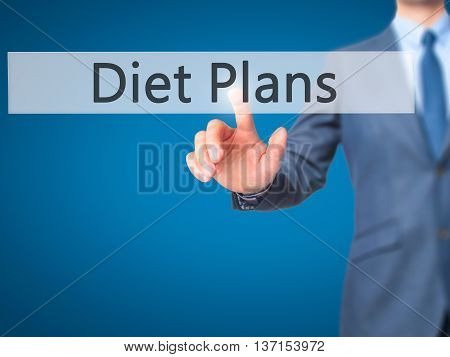 Diet Plans - Businessman Hand Pushing Button On Touch Screen