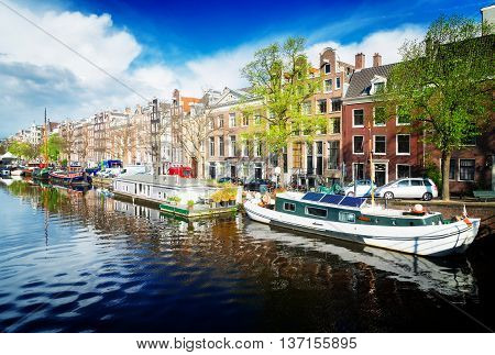 embankment of Amstel canal in Amsterdam at summer day, Netherlands, toned