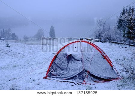 Tent In The Snow At The Mountain Lake