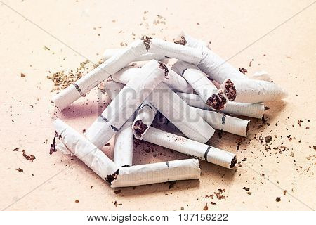 Heap of the broken cigarettes on the paper